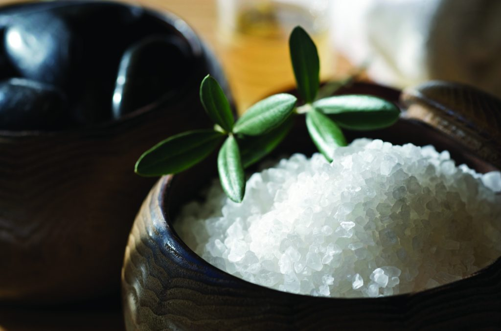 Bath salts, massage stones, and massage oil in a spa atmosphere